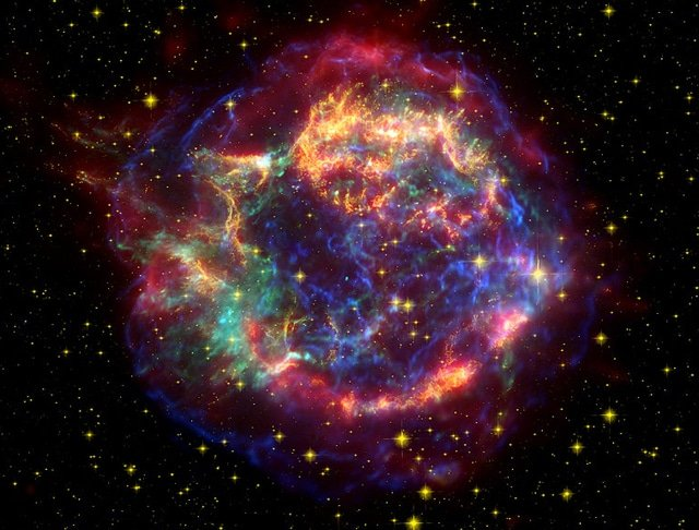 A NASA image of Cassiopeia A combining observations made with the Spitzer, Hubble and Chandra space telescopes.