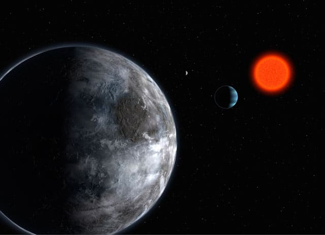 Artist's impression of planets orbiting a red dwarf (ESO)
