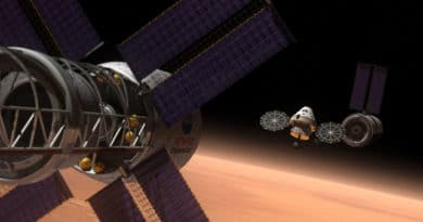 The new Orion, in the distance, imagined in orbit around Mars