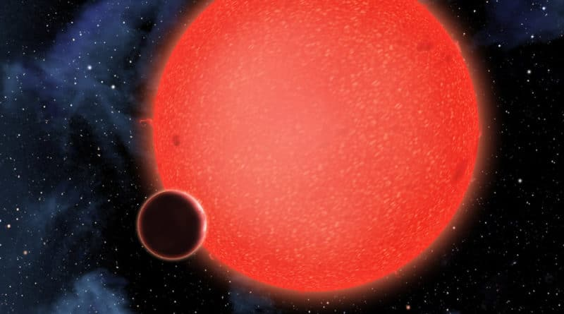 An artist's conception of the new water world orbiting its red dwarf star
