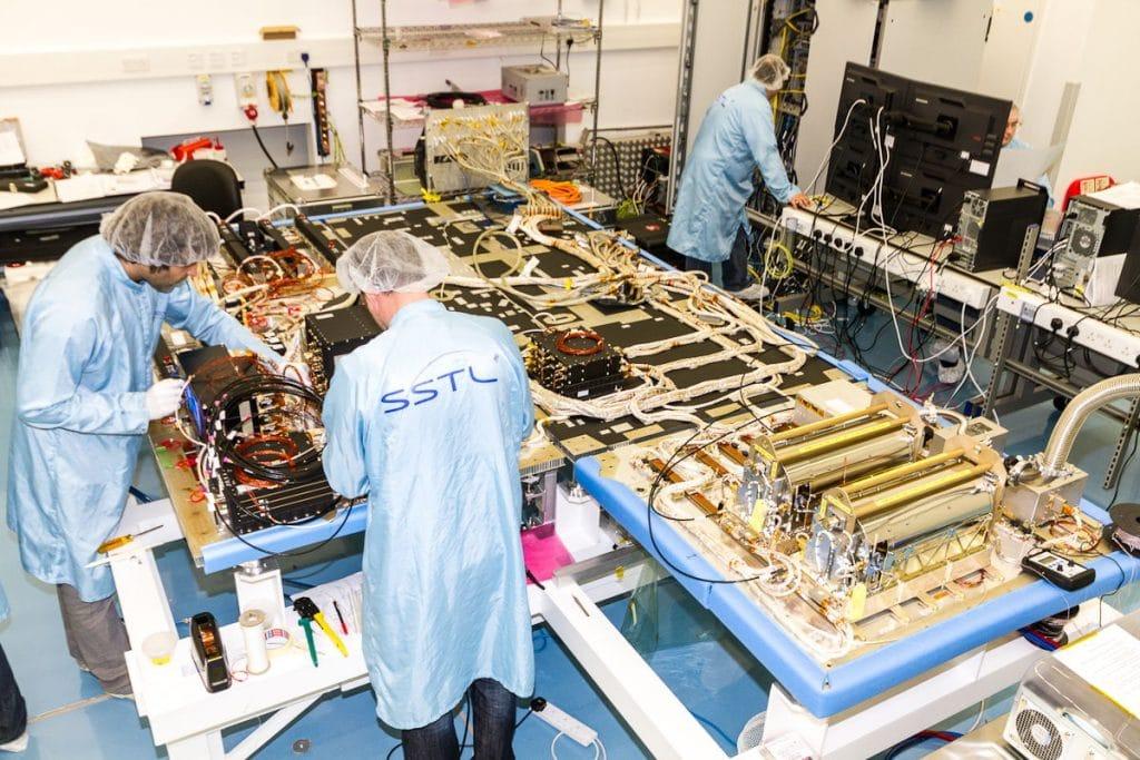 SSTL engineers busy building satellites. Credit: SSTL