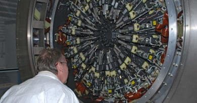 Engineer inspecting the full array of 24 arms fitted to KMOS.