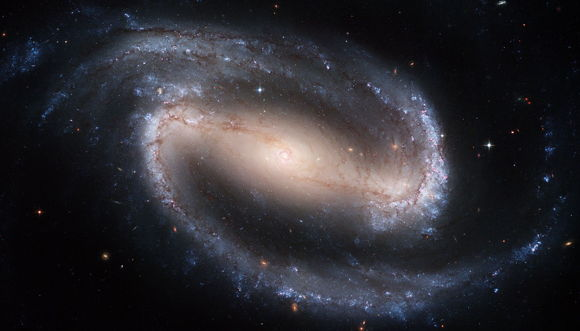 A barred spiral galaxy, similar to the Milky Way, pictured by the Hubble Space Telescope