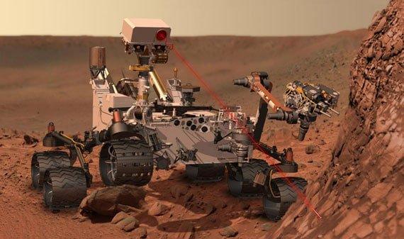 An artist's impression of Curiosity firing its laser at a rock on Mars. Credit: NASA/JPL-Caltech