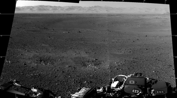 The view towards the mountainous edge of Gale Crater includes foreground areas blasted by Sky Crane's thrusters