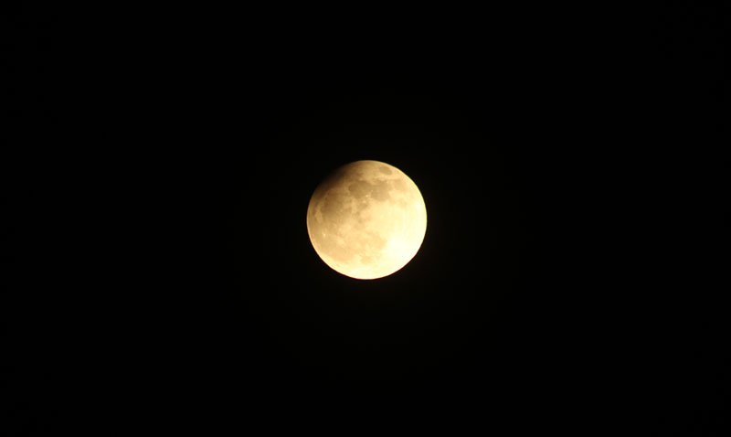 The Moon near mid-eclipse with just the north-western limb darkened