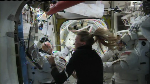 Luca Parmitano recovers back inside the safety of the International Space Station, aided by Karen Nyberg