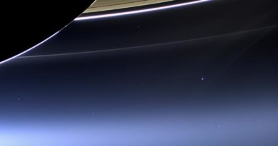 Cassini's latest image of Earth caught beneath Saturn's rings.