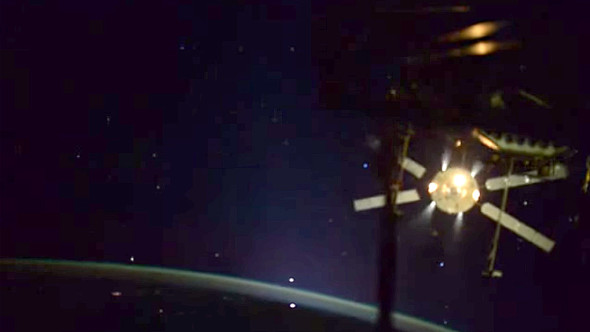 An enhanced view of the ATV-5's departure from the ISS reveals the stars. Image credit: ESA
