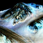 Dark, narrow streaks on Martian slopes are thought to be formed by a seasonal flow of liquid water. They are seen here such on an image of Hale Crater produced by combining 3D modelling with images from the HiRISE camera on board Mars Reconnaissance Orbiter. Image credit: NASA/JPL-Caltech/Univ. of Arizona