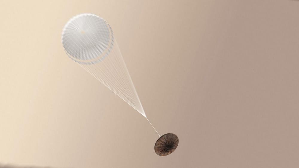 An impression of Schiaparelli with its parachute deployed.