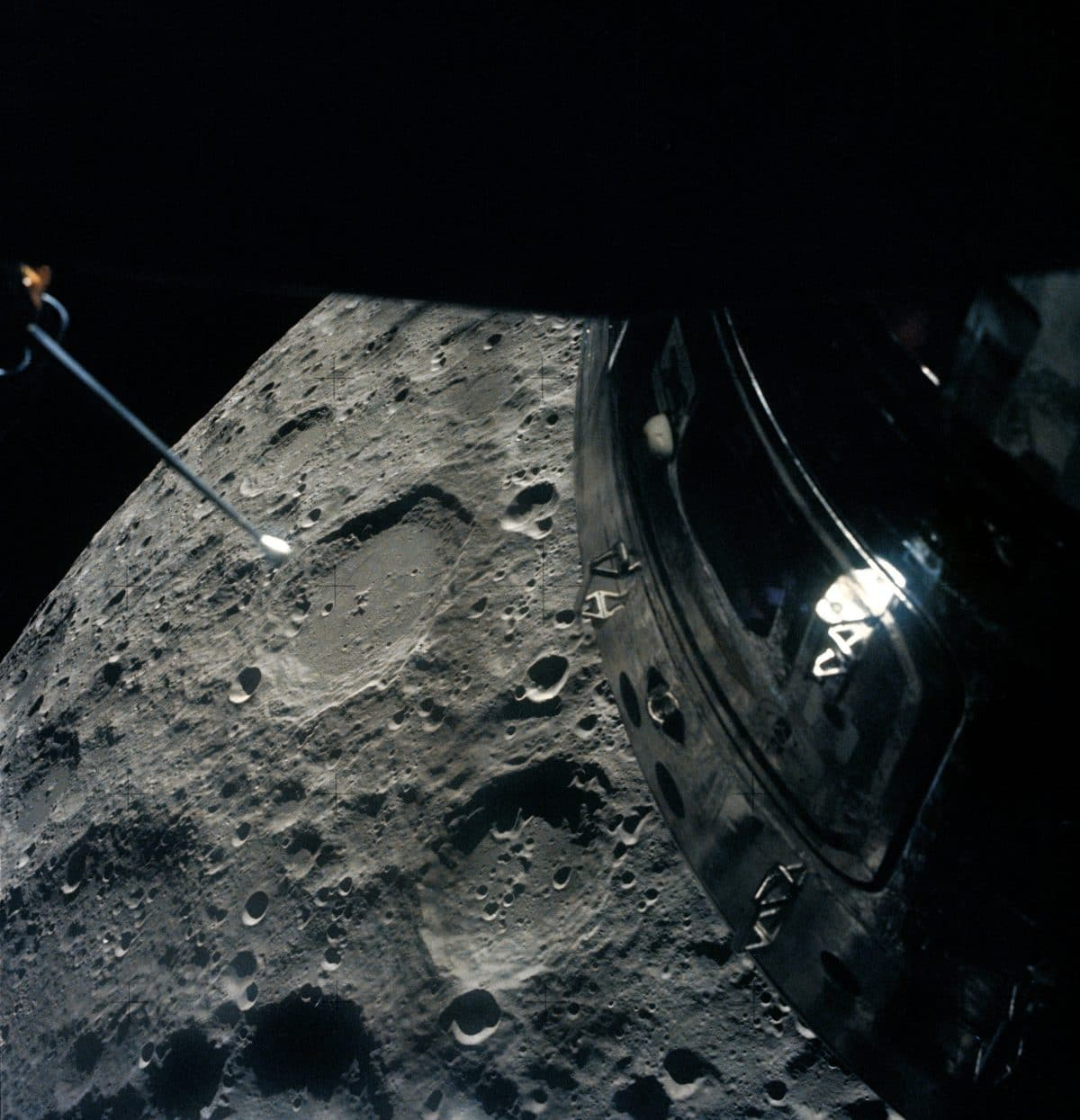 Apollo 13 swings by the Moon