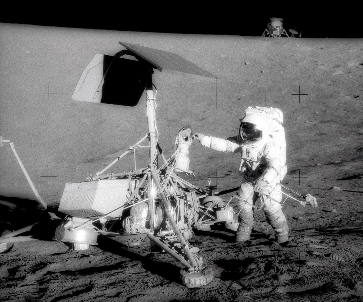 Apollo 12's Pete Conrad checks out Surveyor 3.