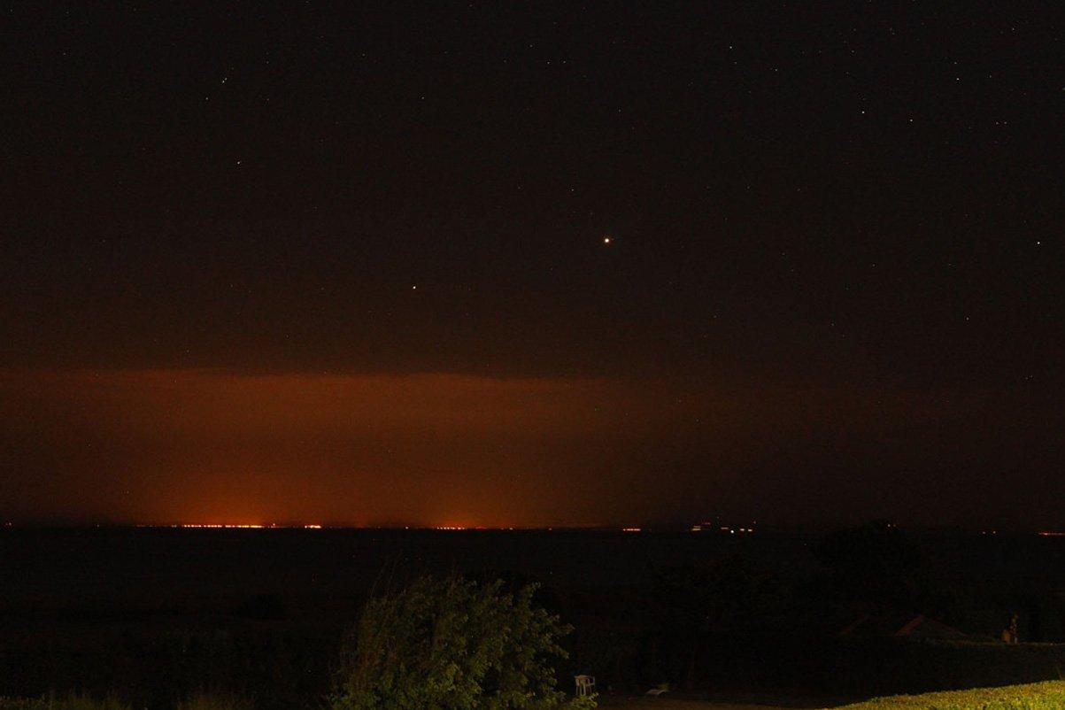 Jupiter, Saturn and a fata morgana mirage